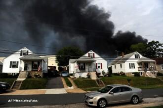 Un tren cu substante chimice a deraiat si a explodat in estul Statelor Unite ale Americii. VIDEO
