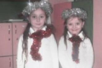 Povestea fetitelor din Ramnicu Sarat, ucise de propriul tata. Colegii de clasa le-au pus lumanari si flori pe banci