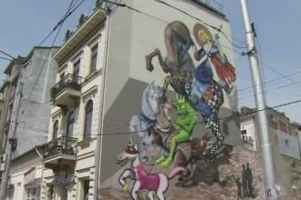 Graffitiul cu Sfantul Gheorghe, din Capitala, a fost acoperit cu var.