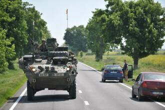 Zeci de blindate americane traverseaza Romania. GALERIE FOTO Unde trebuie sa ajunga