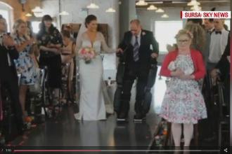 Momentul extrem de emotionant de la o nunta din Marea Britanie. Cum a reusit un tata paralizat sa isi conduca fiica la altar