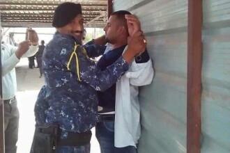 Momentul in care un politist irakian zambeste la camera dupa ce a prins un luptator ISIS. Ce planuia sa faca jihadistul