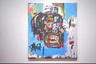 Un tablou al artistului american Jean Michel Basquiat, vandut cu 110.5 milioane de dolari la o licitatie in New York