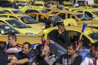 Guvernul vrea ca toate aplicaţiile de taxi să fie controlate de firmele de taximetrie
