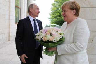 Bild: De ce florile oferite de Putin lui Merkel reprezintă de fapt o jignire