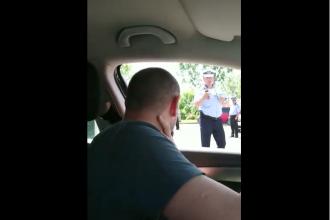 MITINGUL PSD: Un polițist îi cere parola unui șofer care vrea să intre în Târgoviște