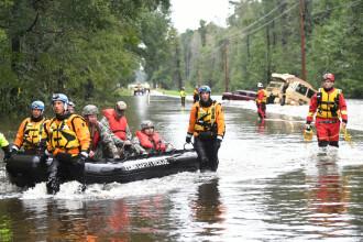 Momentul dramatic în care o femeie este salvată din inundații. VIDEO