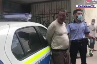 Incendiu cu scandal într-o clădire de patrimoniu din București. Doi bărbați au fost încătușați
