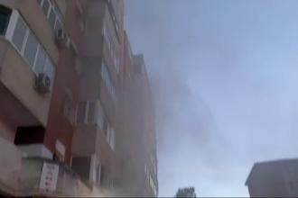 Panică într-un bloc din Craiova. O agenție de pariuri, aflată la parter, cuprinsă de un incendiu