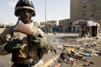 Atentat cu masina-capcana la Bagdad, soldat cu cel putin 13 morti si 39 de raniti. Explozia - intr-un cartier aglomerat