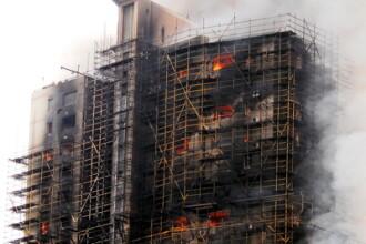Zgarie-nori in flacari la Shanghai! 42 de persoane au murit, 90 sunt ranite