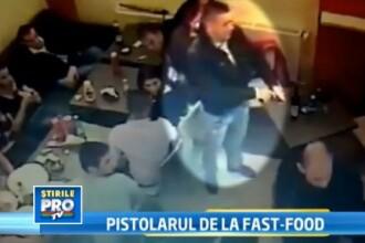 CAMERA DE SUPRAVEGHERE. Scandal intr-un fast-food din Filiasi. Un tanar, impuscat in abdomen