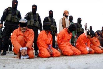 Statul Islamic a executat alti cinci ostatici, in Irak. Jihadistii i-au acuzat de spionaj si i-au impuscat in public