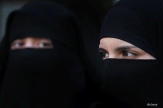 Germania vrea sa aplice o interdictie partiala a portului valului islamic.