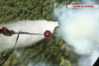 Încendiul din Munţii Semenic a fost lichidat. Un elicopter a efectuat 15 aruncări cu apă