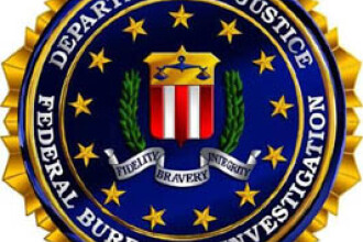 9 romani, prinsi la interventia FBI. Au strans o avere din fraude online