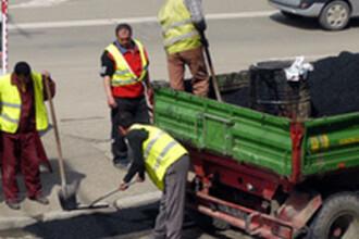 Razboi pentru asfalt in Micul Paris plin de gropi