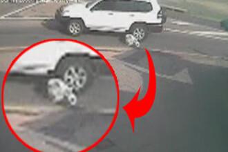 VIDEO SOCANT! O tanara sare din masina si este calcata!