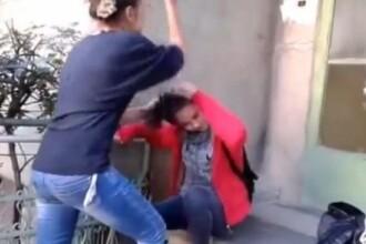 Politia reactioneaza dupa imaginile cu eleva batuta si pusa sa-i sarute picioarele unei colege