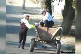 CAMERA DE SUPRAVEGHERE. Un politist din Slatina alearga dupa o caruta incarcata cu caramizi furate
