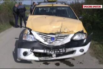Un taximetrist a scapat ca prin minune cu viata, dupa ce masina sa a fost lovita de tren. Trecerea era nesemnalizata