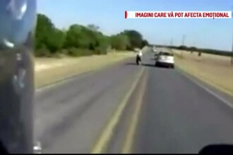 Un sofer din SUA ar fi lovit intentionat cu masina un motociclist, care voia sa il depaseasca. Momentul a fost filmat. VIDEO