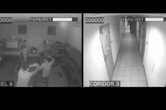Momentul în care un deţinut e omorât în bătaie de colegii de celulă. Poliţiştii asistă, dar nu intervin. VIDEO