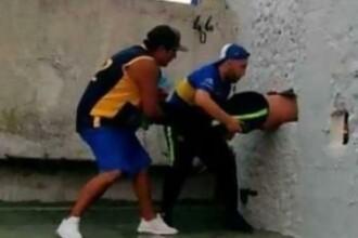 Suporter blocat într-un zid, după ce a încercat să intre ilegal pe un stadion