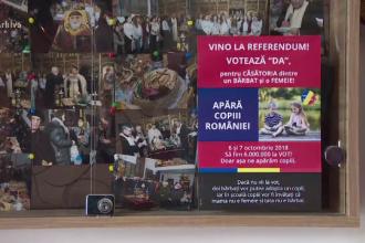 Amenda primită de un preot pentru că a lipit afişe pro-referendum în blocurile din Neamț
