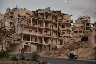 Zeci de civili, printre 7 copii, ucişi într-un raid care viza Statul Islamic
