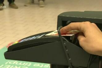 80% dintre români folosesc cardul o dată pe lună. Ce fac cu el în acea zi