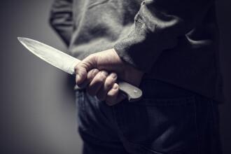 Femeie din Botoșani, amenințată cu un cuțit în timp ce ducea gunoiul