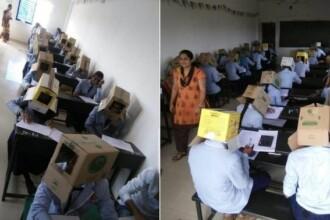Scandal în India. Elevii unei școli au fost puși să poarte cutii pe cap la examen