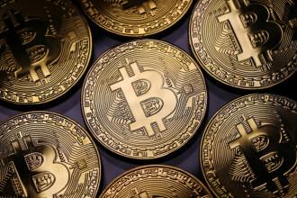 Statul scoate la vânzare monede virtuale confiscate într-un dosar de înșelăciune. Care este procedura