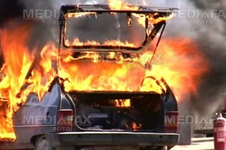 Au dat foc masinilor ca sa elibereze locurile de parcare
