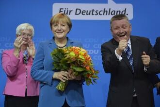 Angela Merkel saluta un