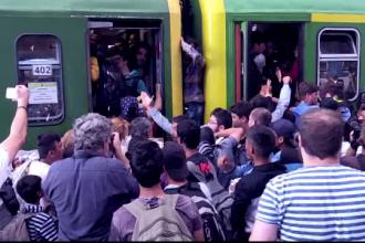 Trenuri cu imigranti plecate din Budapesta, oprite de autoritati. Filmul unei zile cu confruntari intre refugiati si Politie