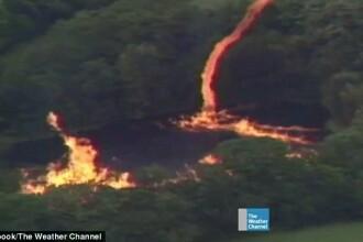 Imagini uimitoare in Kentucky. 3 milioane de litri de alcool au ajuns intr-un rau, iar un trasnet a pornit un incendiu. VIDEO