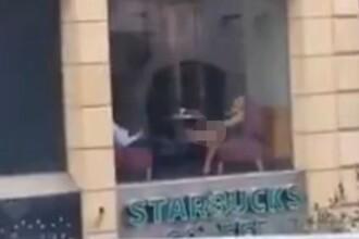 Imagini incredibile, filmate intr-o cafenea. Momentul in care o femeie se atingea in zone intime in fata iubitului, la masa