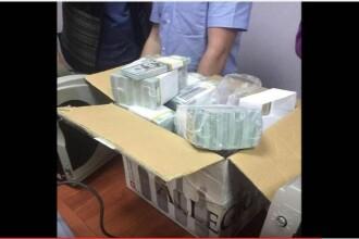 Un oficial rus a fost arestat, dupa ce s-au gasit gramezi de bani in casa lui. Suma fabuloasa descoperita de anchetatori
