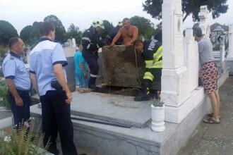 """Câine îngropat de viu într-un mormânt dintr-un cimitir din Timiş. Explicaţia uluitoare a """"autorului"""""""