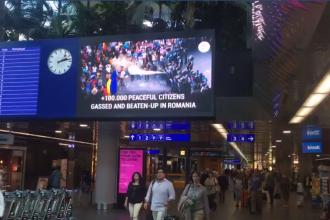 Un spot video cu imagini de la protestul din 10 august rulează în aeroportul din Geneva. VIDEO