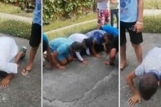 """VIDEO. Copii puși să facă mătănii pe asfalt, în Sălaj. """"Vă puneți pampers sau alte soluții"""""""