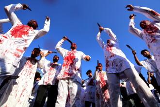 Imagini șocante la un festival din Irak. Oamenii s-au tăiat cu săbiile pe cap