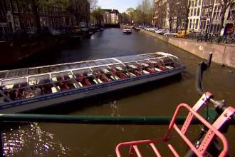 Amsterdam impune turiștilor cea mai mare taxă din Europa. Cât vor avea de plătit