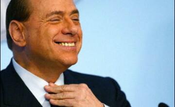 Băsescu tratează problema romilor din Italia cu Berlusconi