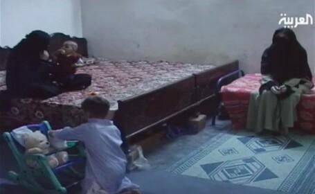 Primele imagini cu vaduvele si copiii lui Osama bin Laden in puscarie. VIDEO