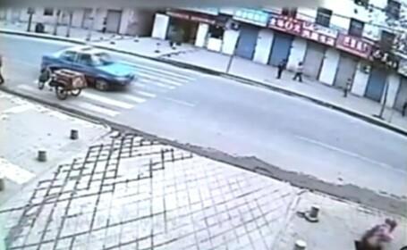 Asfalt de 2 yuani in China. Momentul in care unei tinere ii fuge pamantul de sub picioare. VIDEO
