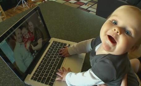 Un baietel de 8 luni din SUA i-a lasat pe ai lui fara 600 de dolari cu o singura apasare de tasta. Cum a fost posibil