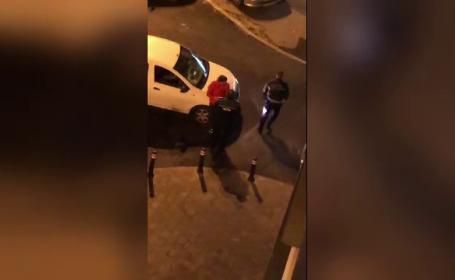 Un polițist, filmat în timp ce lovea violent un bărbat, în Capitală